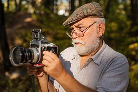 Vintage Is My Style. Old Photographer Look In Vintage Camera Outdoors. Bearded Pensioner Take Travel