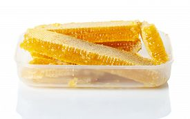 Honey In Honeycombs In A Plastic Box On A White Background, Isolate