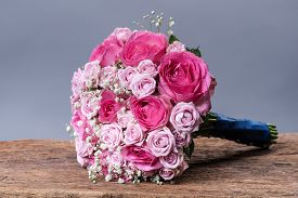 Round Bouquet Of Roses On A Background Of Wooden Boards With A Place For Text