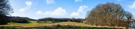 Countryside Panorama Landscape In The Early Spring With A Trail Going Through The Scenery