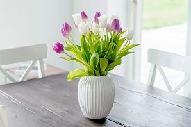 Bouquet Of Tulip Flowers In A White Vase On A Wooden Table In The Springtime