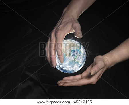 Crystal Globe And Hands