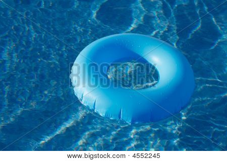 Blue Ring Floating On  Crystal Clear  Water Pool