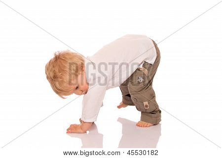 Young Boy Learning To Walk