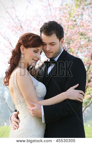 Young Bride and Groom Embrace