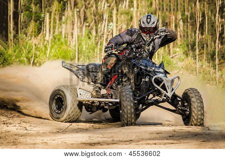 Atv Racer Takes A Turn During A Race.
