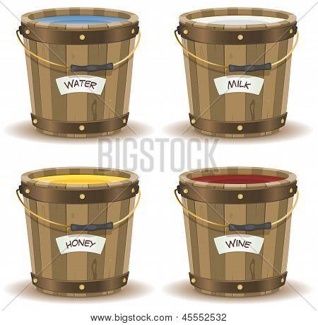 Water, Milk, Honey And Wine Inside Wood Bucket