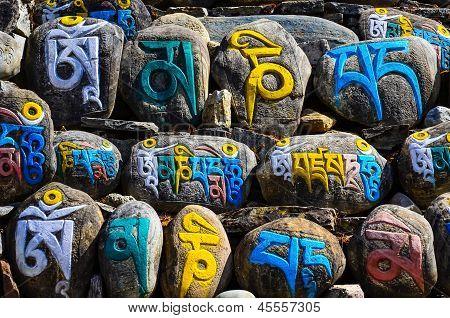 Tibetan Religious Budhist Symbols On Stones