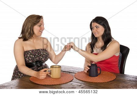 Showing Engagement Ring To Friend