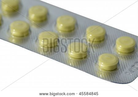 Yellow pills in blister