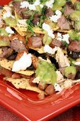 An exquisite organic mexican nachos with wheat corn tortilla and hormone free beef poster