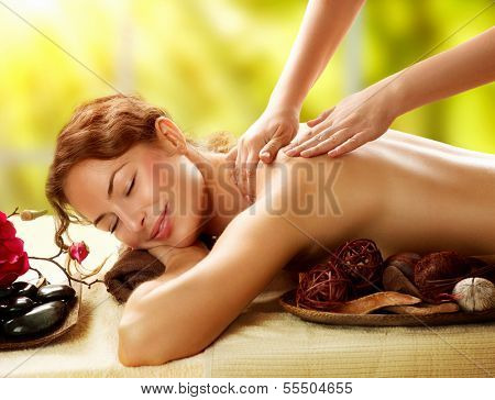 poster of Spa. Beautiful Woman in Spa Salon getting Massage. Healthy massage of body in spa salon. Beauty treatment concept. Masseur doing massage. Relaxing
