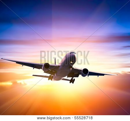 Airplane in the sky at sunrise poster