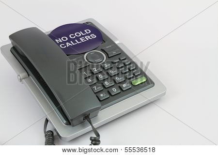 No cold callers sticker on a telephone set