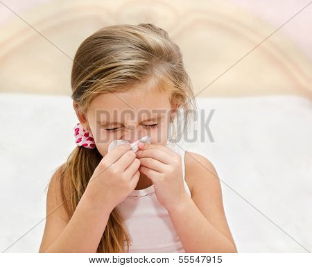 Little Girl Blowing Her Nose In A Great Effort