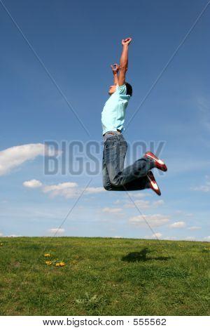 Man Jumping Against Blue Sky