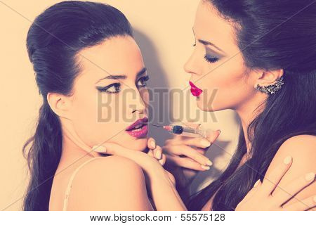 two women acting beauty treatments lip augmentation
