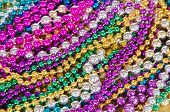Colorful and festive Mardi Gras beads for background poster