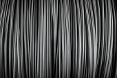 Large coil of Aluminum wire background texture poster