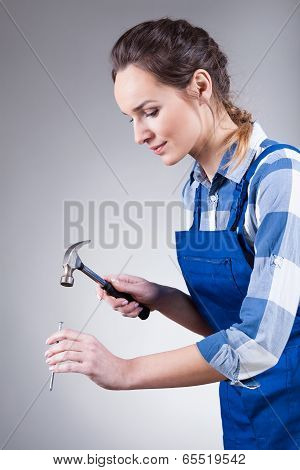 Woman With Hammer And Spike