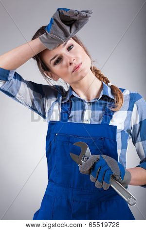 Tired Woman Holding Wrench