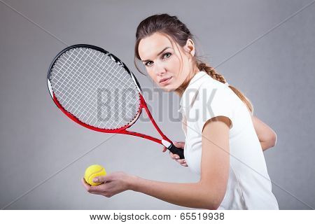 Focused Woman Playing Tennis