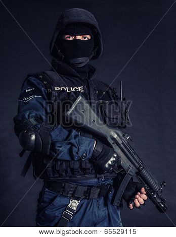 Special weapons and tactics SWAT team officer on black background poster