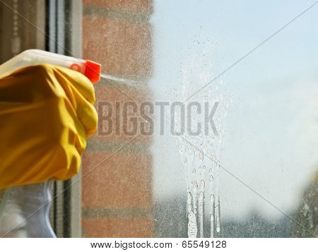 Soapy Jet From Spray Bottle On Window Glass