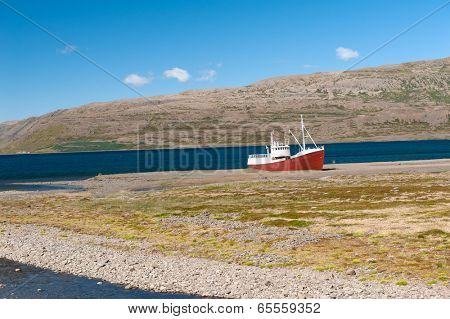 Old fishing boat that shipwrecked in one of the fjords of the Iceland in the Westfjords