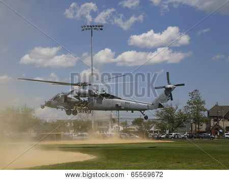 MH-60S helicopter from Helicopter Sea Combat Squadron Five with US Navy EOD team taking off