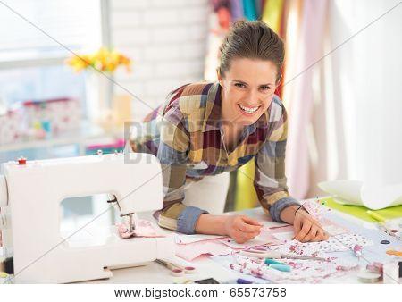 Happy Seamstress Working In Studio