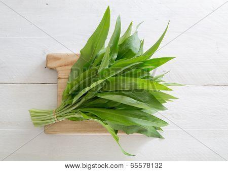 Fresh Wild Garlic On A Wooden Board