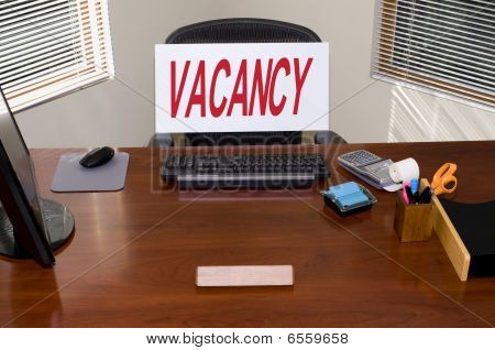 Desk And Vacancy Sign