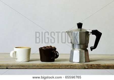 Two Cups Of Coffee And Beans And Percolator