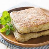 Mutabbaq or murtabak is a popular middle east stuffed bread poster