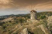 old windmill has been restored Foca Izmir poster