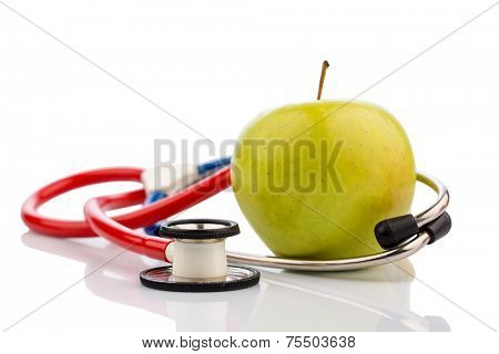 an apple and a stethoscope on a doctor. symbol photo for healthy and vitamin-rich diet.