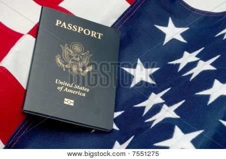 A Horizontal Image Of An American Passport On An American Flag