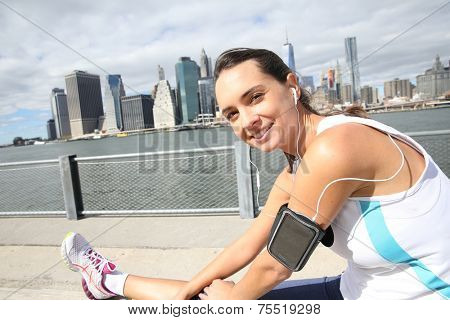 Woman stretching out after running on Brooklyn Heights promenade