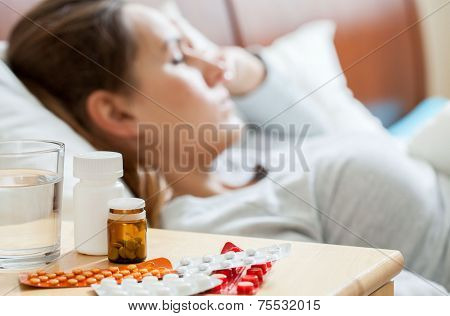 Sick Woman Sleeping In Bedroom
