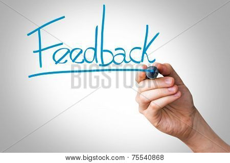 Hand writing with a blue mark on a transparent board - Feedback