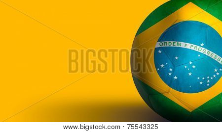 Soccer ball with Brazil flag isolated on yellow
