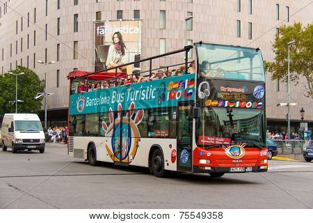 BARCELONA, SPAIN - JUNE 2: Tourist bus in Barcelona, Spain on June 2, 2012. Barcelona City Tour is a new official touristic bus service that shows the city with an audio guide.