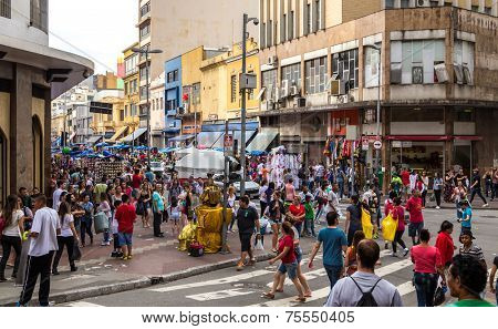 SAO PAULO, BRAZIL - AUGUST 31: People walks along the 25 March area in August 31, 2013 in Sao Paulo, Brazil. 25 March Area, is a popular commerce region near the center of Sao Paulo, Brazil.