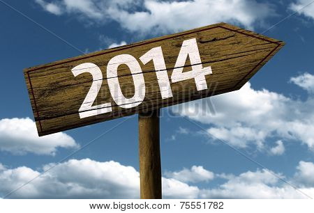 2014 wooden sign with a beautiful sky on background