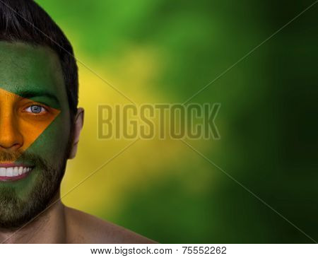 Portrait of a man with a painted flag of Brazil - Latin America
