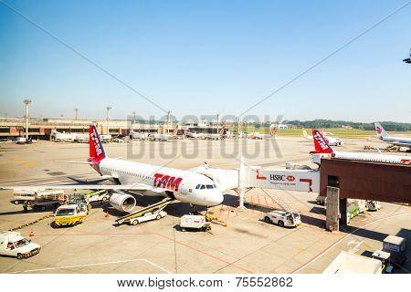 SAO PAULO, BRAZIL - NOV 16: TAM Airplane in Guarulhos Airport on November 16, 2013 in Sao Paulo, Brazil. Guarulhos Airport is the main airport in Brazil.