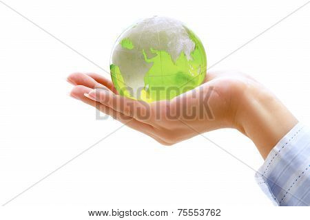 Human hands holding glass earth, isolated on white background