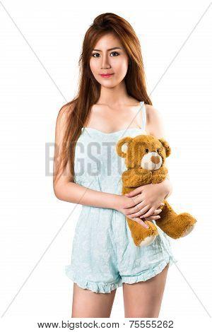 Teenage girl holding her teddybear isolated over white