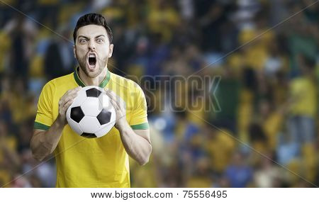 Brazilian man holding a soccer ball celebrates on the Arena background